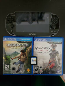 PS VITA with 2 games and a 8gb  memory card $170 price +2 games
