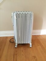 Oil space heater by DeLonghi for sale