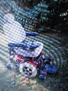 MOTORIZED WHEELCHAIR-HIGH END CHAIR(USED TWO MONTHS)