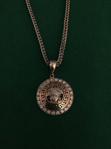 10k Gold chain and Versace pendant