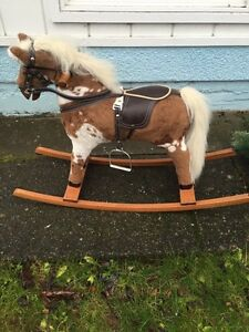 Wood and fabric Rockinghorse and excellent clean condition