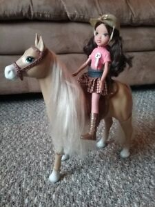 Horse rider Barbie doll on a mechanical horse that walks.