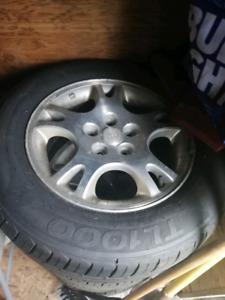 TL100 All season tires on dodge rims. 225/60R16s