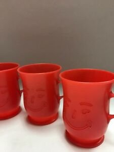 4 Vintage red Kool Aid Man Cups made of plastic