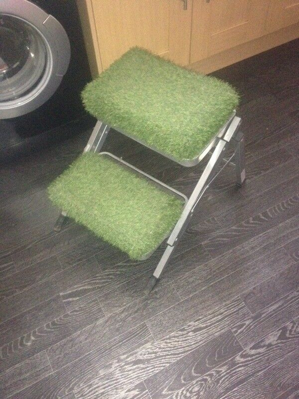 Step ladders covered in artificial grass