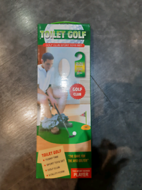 Novelty toilet golf set