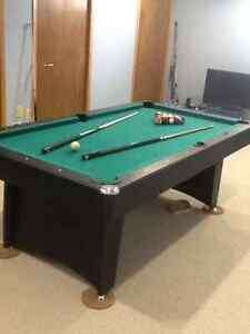 7 X 4 foot playing surface pool table in excellent condition.