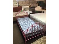Pink single metal bed with mattress