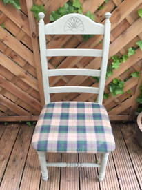 Wood chair with soft cushion.