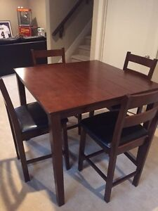Pub height table and four chairs