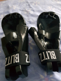 Boxing gloves by Blitz. For boys or girls