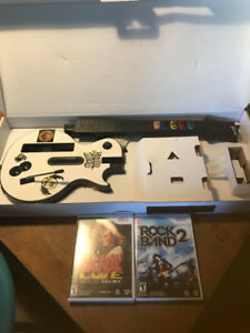 WII Guitar and 2 Games