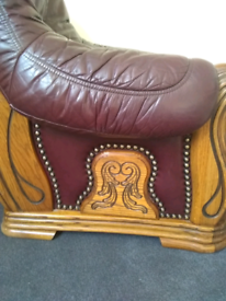 Gorgeous vintage leather and carved wood armchair. Great condition.