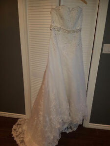 Never worn white wedding dress with lace