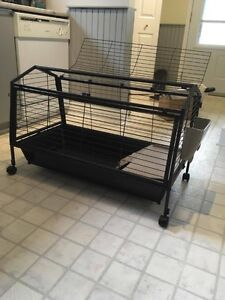Black metal pet cage with caster wheels
