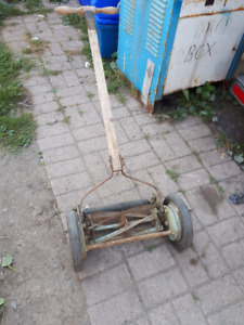 antique push lawnmower works great