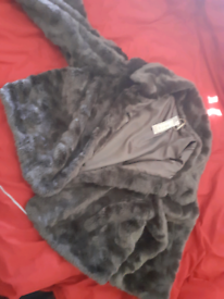 Womans beautiful faux fur coat