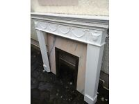 White fire surround with marble back and hearth