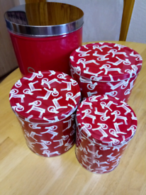 NEXT RED BREAD BIN, WITH THREE OTHER STORAGE CANISTER 'S