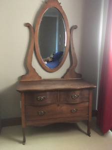 Antique solid oak dresser with oval beveled mirror