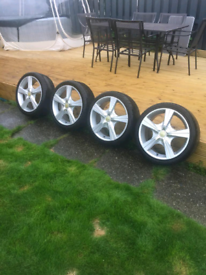 Five spoke alloy wheels with tyres