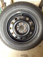 Winter tires (4) on rims - 205 65 R15
