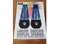 Water dancing droplets speaker