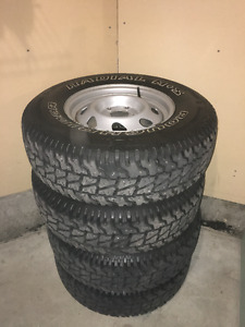 Four Roughrider P235/75R15 Tires + Rims 100% Tread