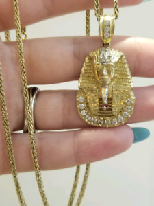 King tut pendant and round franco chain 10k gold
