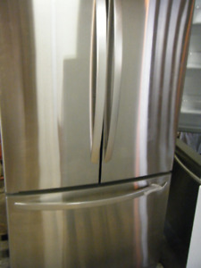 LG Stainless 20,7 cu ft Refrigerator + more appliances