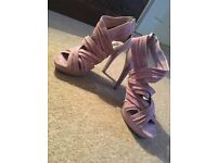 Size 4, pink heels- worn once.