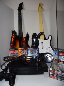 Sony PlayStation 2 Black w/ 2 Guitars 11 PS2 Games 1 Controller