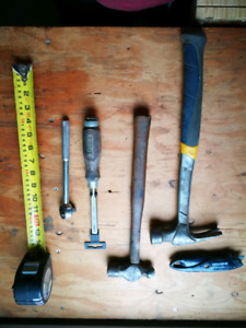 Assorted carpenter hand tools hammers