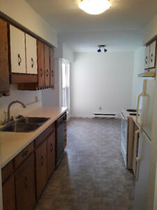 Bright Spacious top floor 2 Bedroom Apartment Unit with Laundry