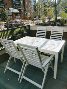 White extendable patio table  & reclining chairs