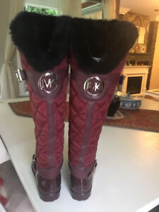 A pair of womens Mikeal Kors rain boots