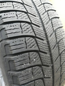 Four winter tires Michelin 195/65/15 with rims