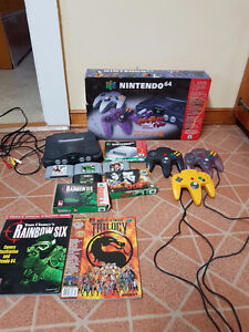 Nintendo 64 w/ 3 Controllers and 4 games all accessories!
