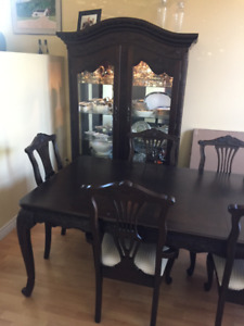 Dark Wood Dining Room Set with Hand Carved Finishes For Sale