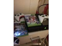 Xbox 360 and iPhone 5s with cracked screen