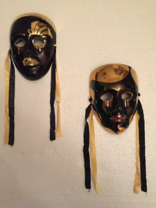 Retro male and female metal wall masks