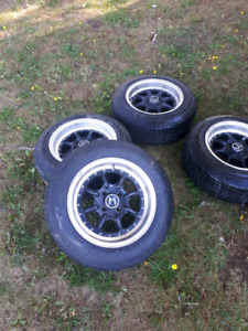 """4x100 15"""" Honda civic aftermakert rims and tires"""