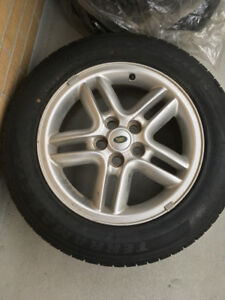 (1) new spare tire and  rim 235/60/18
