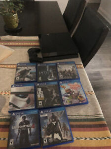 500GB playstation 4 Great condition. with new control and games