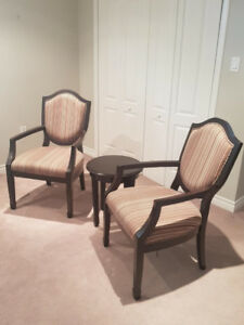 Two Victoria chairs with centre table