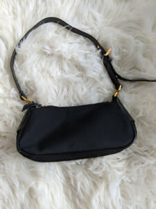 Small black XOXO purse with gold details