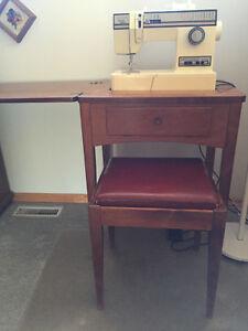 Singer sewing machine in walnut cabinet