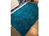 Large Teal Henley style rug.