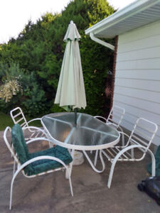 patio set: oval table + 4 chairs + cushions + umbrella & weight