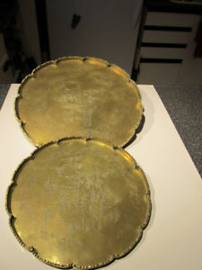 Set of 2 antique thick engraved brass trays.